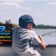 Young Boy Fishing on a Boat