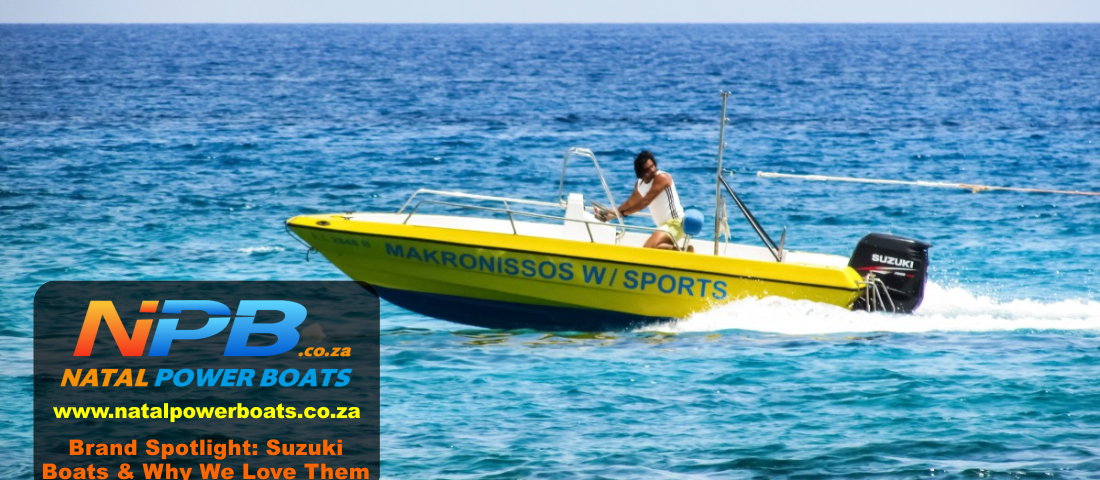 a yellow boat with a Suzuki boat motor on the water