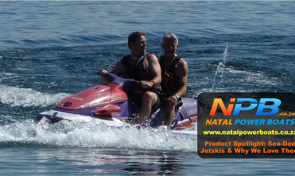 a man and woman in a Sea-Doo jet ski on the water