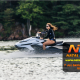a brown-haired woman using a jet ski